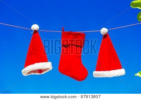 Christmas concept: santa hats and stocking background blue sky