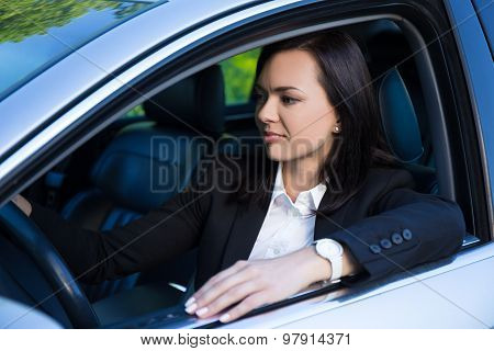 Young Successful Business Woman Driving Her Car