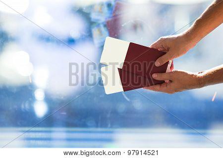 Closeup passports and boarding pass at airport indoor