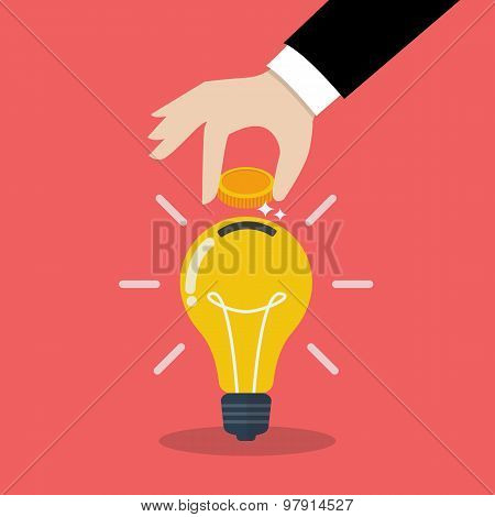 Hand Inserting Coin In Light Bulb