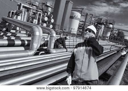 giant pipeline construction, engineer checking for leaks, oil industry