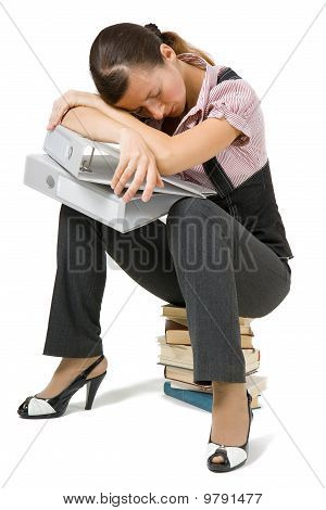 Young Girl Asleep Sitting On The Books