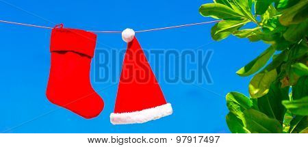 Christmas concept: santa hat and stocking background blue sky