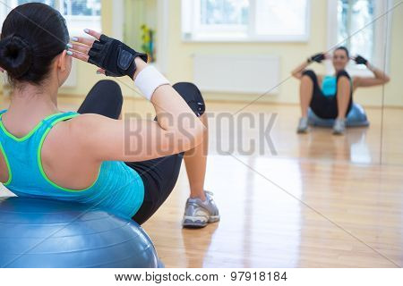 Sport Concept - Young Sporty Woman Doing Exercises On Bosu Ball