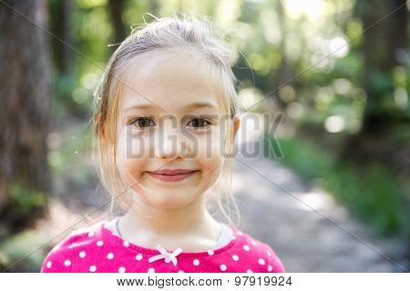 Little Girl Enjoying A Hike Through The Woods