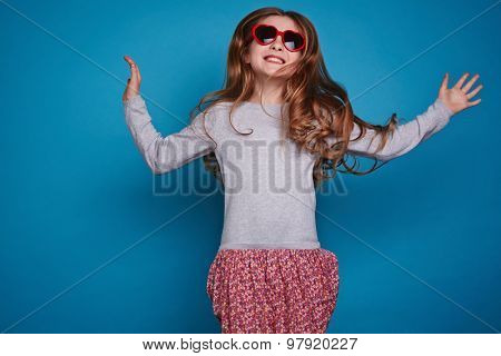 Pretty girl in heartshaped sunglasses and casualwear