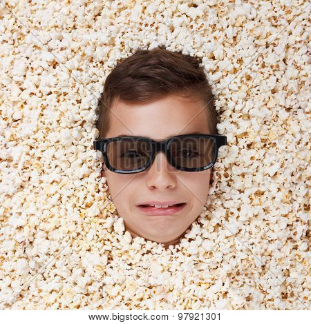 Sad Crying Young Boy In Stereo Glasses Looking Out Of Popcorn