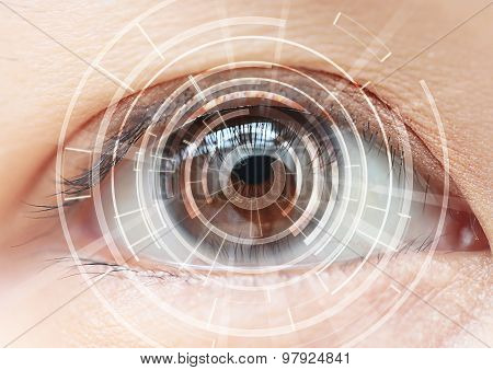 Close-up Of Woman's Brown Eye. High Technologies In The Future