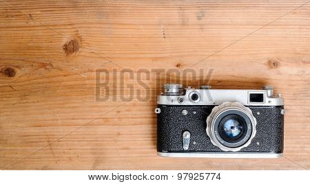 Retro Camera On Wooden Background