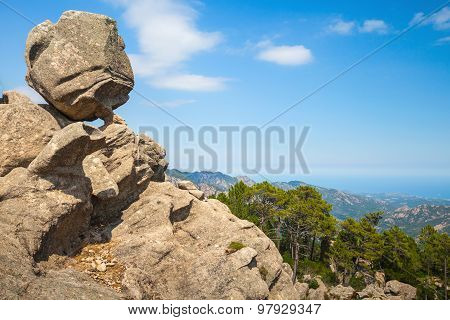Big Round Stone Lays On Top Of A Coastal Rock