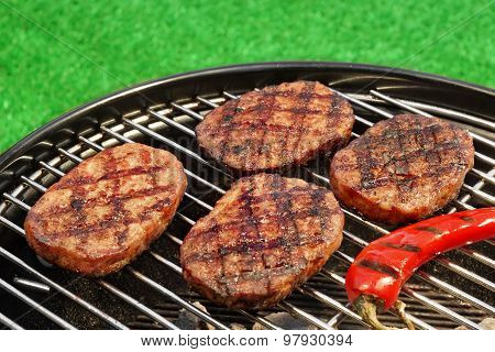 Bbq Hamburger Patties And Chili Pepper On The Hot Grill
