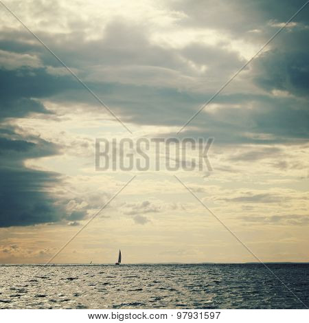 Sailing Ship Profile. Toned Image. Rainy Clouds.