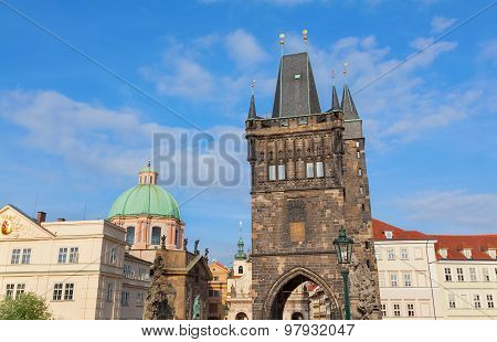 View Of The Tower On Charles Bridge In Prague With The Hurch Of St Francis In The Background