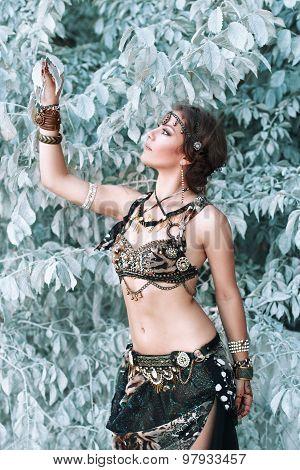 Pretty Woman In Tribal Fusion Costume Near The Beautiful White Fairy Tree.
