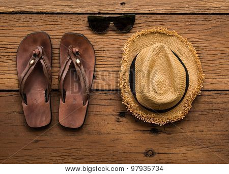 Leather Sandals And Wicker Hat And Sunglass