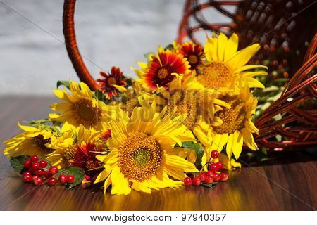 Sunflowers With Flowers And Viburnum Lies In A Basket