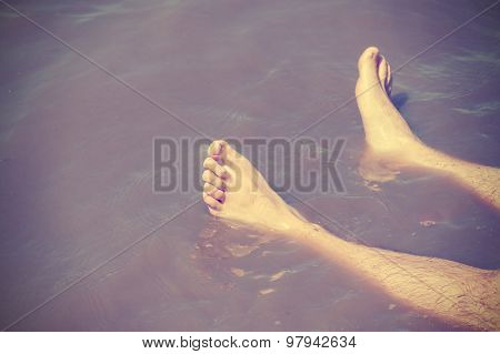 Vintage Filtered Male Bare Feet In Lake Water, Relax Concept.