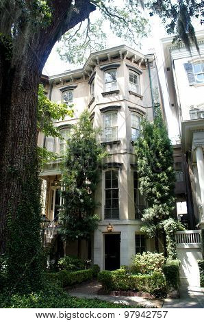 Savannah, Georgia, USA - JUNE 20, 2015 -  historic district house and oak trees.
