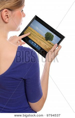 Woman Holding A Touchpad Pc Showing A Movie