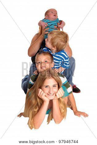 Pyramid Of Four Kids On Floor.