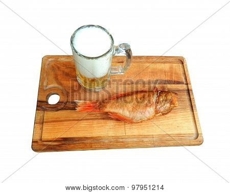 Mug of beer and smoked sea bass on a wooden board, isolated on white background