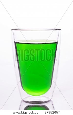 Glass of green water