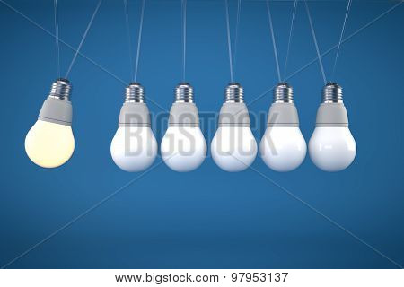 Newton's Cradle Concept With Light Bulb On Blue Background