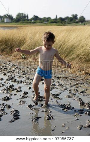 Boy Goes On Healing Mud