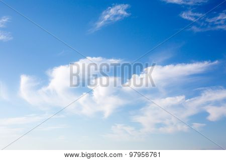 Idyllic White Fluffy Clouds In The Blue Sky