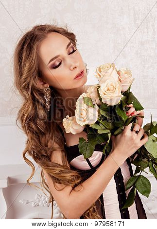 Beautiful Girl Holding A Bouquet Of White Roses.  Girl Closed Her Eyes And Smelling A Flowers