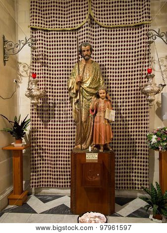 Nazaret, Israel, July 8, 2015: The Figure Of St. Joseph With Jesus In The Church Of St. Joseph In Na