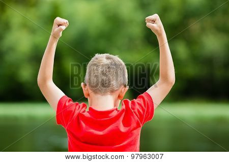 Boy With Raised Arms
