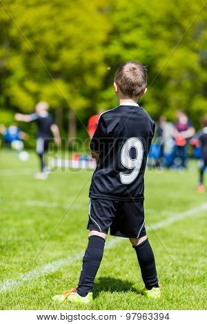 Young Boy Watching A Kids Soccer Match
