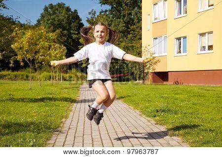 Little Girl Jumping Rope Outside