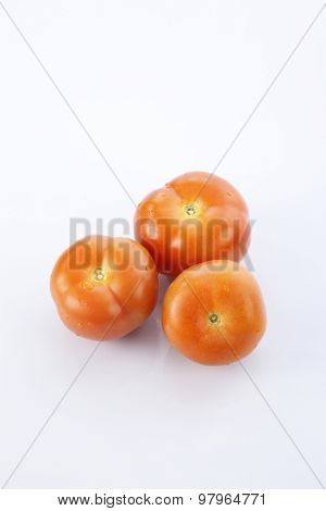 top view of tomatoes on the white backgrond
