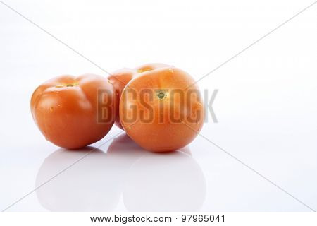 tomatoes on the white backgrond