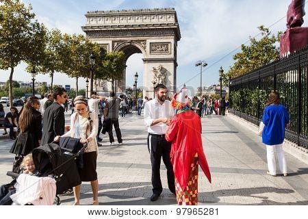 Paris - October 14, 2014: Arc De Triomphe Against Nice Blue Sky