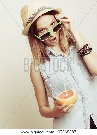 Happy Woman In Hat And Sunglasses With Grapefruit