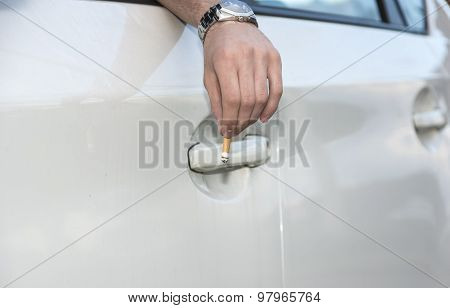 Man Tossing Cigarette from Open Car Window