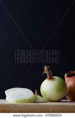 Onions Arranged On Chopping Board