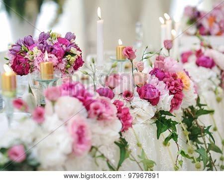 Wedding decoration on table. Floral arrangements and decoration. Arrangement of pink flowers