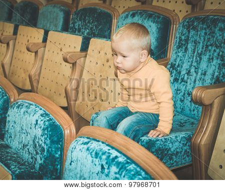 Baby sitting in a theatre