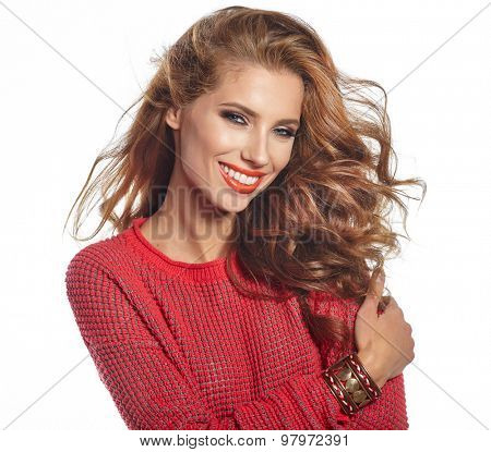 Portrait of wonderful young woman with long hair looking at camera, smiling.