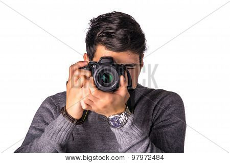 Handsome young male photographer taking photograph