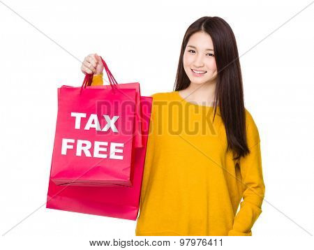 Woman hold with red shopping bag and showing tax free