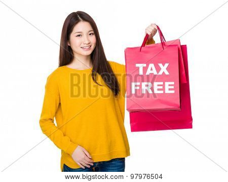 Woman hold with shopping bag showing tax free