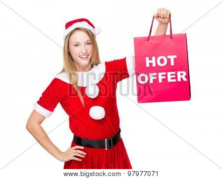 Christmas party dressing girl with shopping bag showing hot offer