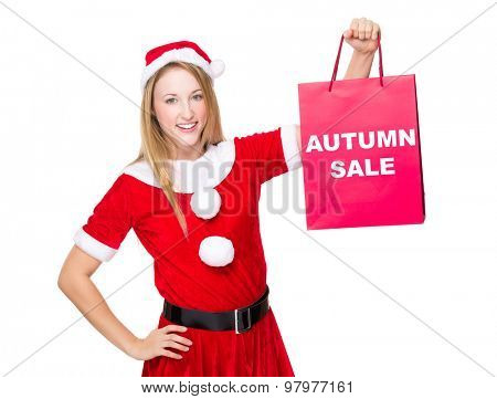 Christmas party dressing girl with shopping bag showing autumn sale