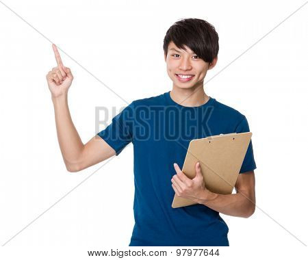 Asian young man hold with clipboard and finger point up
