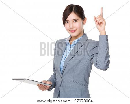 Young Businesswoman use of the digital tablet and finger point up